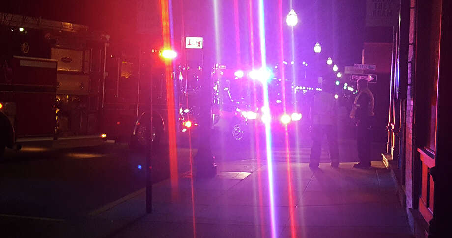 First responders block off a portion of the road at the intersection of Main and College Streets to assist a struck pedestrian. Photo: Zachary Foote • Intelligencer