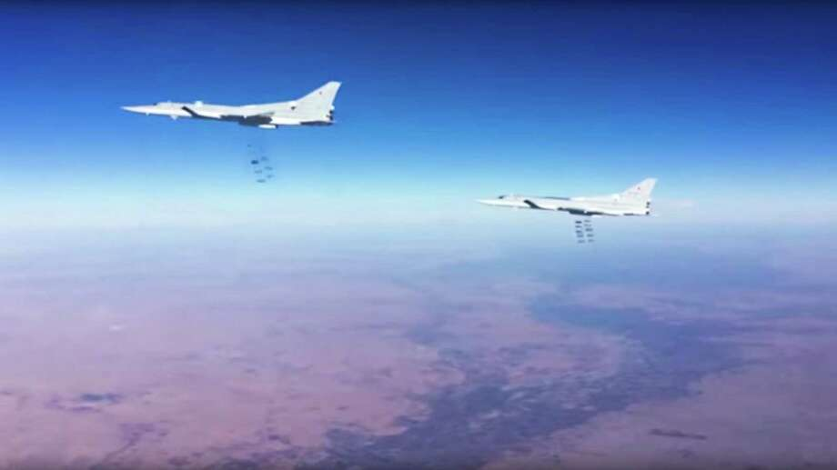 This photo provided by the Russian Defense Ministry Press Service shows Russian air force Tu-22M3 bombers strike the Islamic State group wldtargets in Syria on Tuesday, Jan. 24, 2017. The mission, the third such bombing raid in four days, targeted the Islamic State group around Deir el-Zour in eastern Syria where the Islamic State group has launched an offensive against Syrian government forces. (Russian Defense Ministry Press Service Photo via AP) Photo: Associated Press / Russian Defense Ministry Press Service