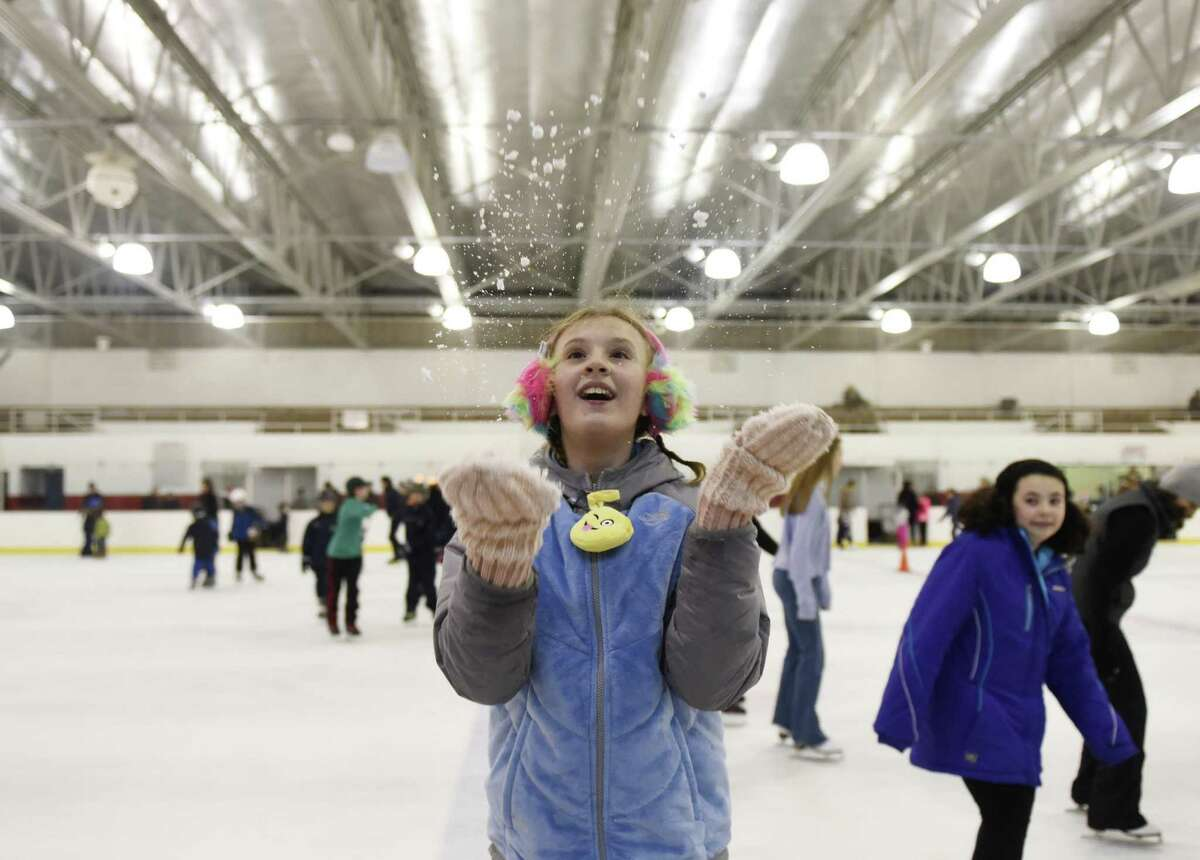 Above, Kristin Koellmer, 10, of Greenwich, throws ice shavings into the air during the public skating session at Hamill Rink in the Byram section of Greenwich, Conn. Sunday, Jan. 22, 2017. Hamill Rink has public skating on the weekends from 2 p.m. to 4 p.m. as well as several different times throughout the week.