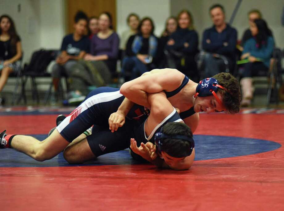 GFA junior JC Foster takes down a wrestler from Marvelwood School. Foster won his 138 lb. match to contribute to the team's overall 39-12 win. Photo: Contributed / Photo
