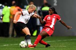 Germany's player Tabea Kemme (L) vies for the ball with Canada's player Nichelle Prince during the Rio 2016 Olympic Games first Round Group F women's football match Canada vs Germany, at the Mane Garrincha Stadium in Brasilia on August 9, 2016. / AFP / EVARISTO SA        (Photo credit should read EVARISTO SA/AFP/Getty Images)