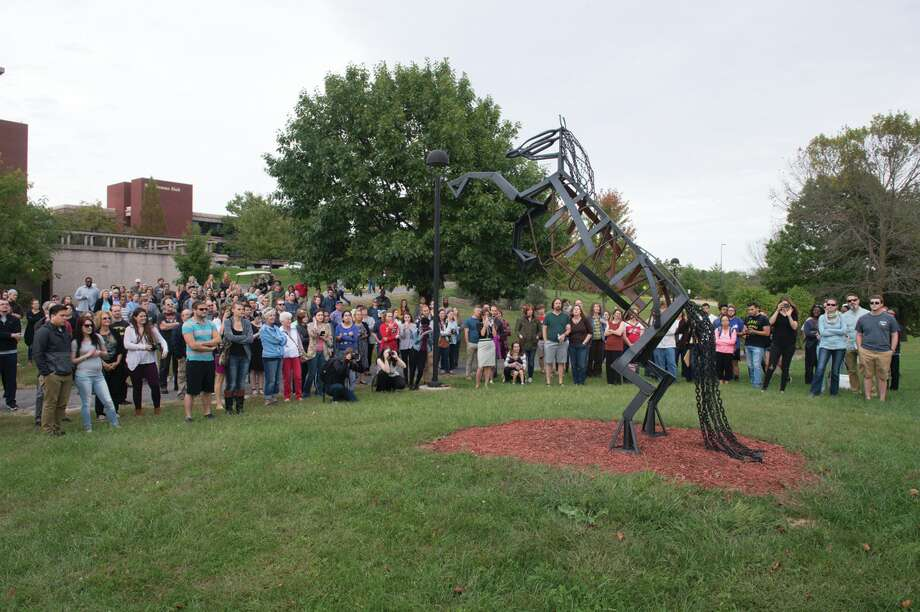 A crowd gathers to view one of the pieces featured in the 2016 Sculpture Walk at SIUE. Photo: SIUE Photo