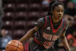 Chasity Patterson of North Shore dribbles during a game Saturday February 27, 2016. North Shore played Clear Springs in the girls basketball Region III finals at the Campbell Center. (Michael Starghill, Jr.)