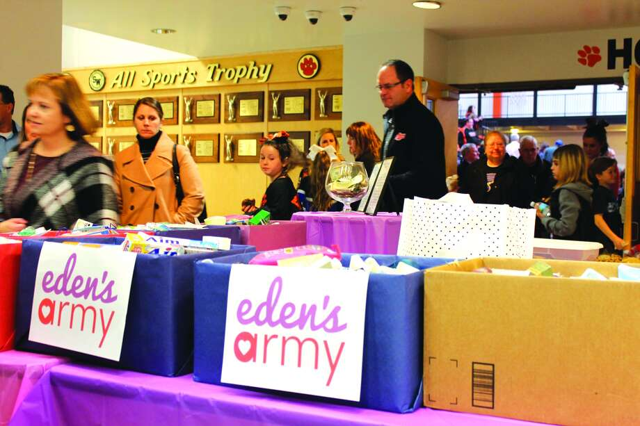 Boxes of toiletries donated for Eden's Army sit in the Edwardsville High School Commons as spectators file out of the gym after the Jan. 17 Edwardsville Cheer Showcase. Photo: Bill Tucker • Intelligencer