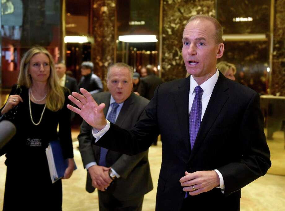 (FILES) This file photo taken on January 17, 2017 shows Boeing CEO Dennis Muilenburg talking to the press after meeting with US President-elect Donald Trump at Trump Tower in New York. Boeing projected January 25, 2017 higher commercial aircraft deliveries in 2017 compared with last year as it reported a 59 percent jump in fourth-quarter earnings to $1.6 billion. / AFP PHOTO / TIMOTHY A. CLARYTIMOTHY A. CLARY/AFP/Getty Images Photo: TIMOTHY A. CLARY, Staff / AFP/Getty Images / AFP or licensors
