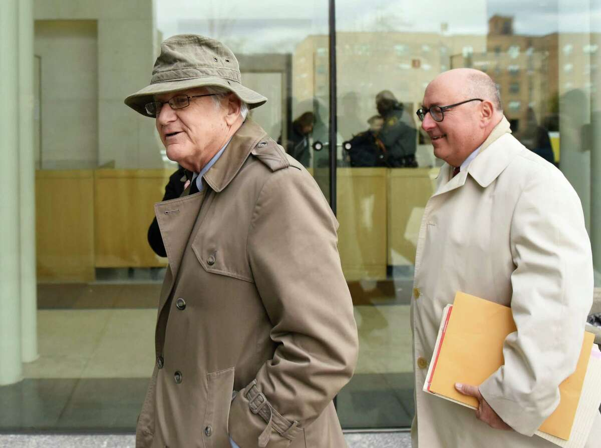 Greenwich Representative Town Meeting (RTM) member Christopher von Keyserling, left, and his attorney Phil Russel enter the Connecticut Superior Court in Stamford, Conn. Wednesday, Jan. 25, 2017. Von Keyserling is accused of fourth-degree sexual assault after allegedly groping a woman following an argument between the two in December. The Center for Sexual Assault Crisis Counseling and Education and community activists peacefully assembled as von Keyserling entered and exited the courthouse.