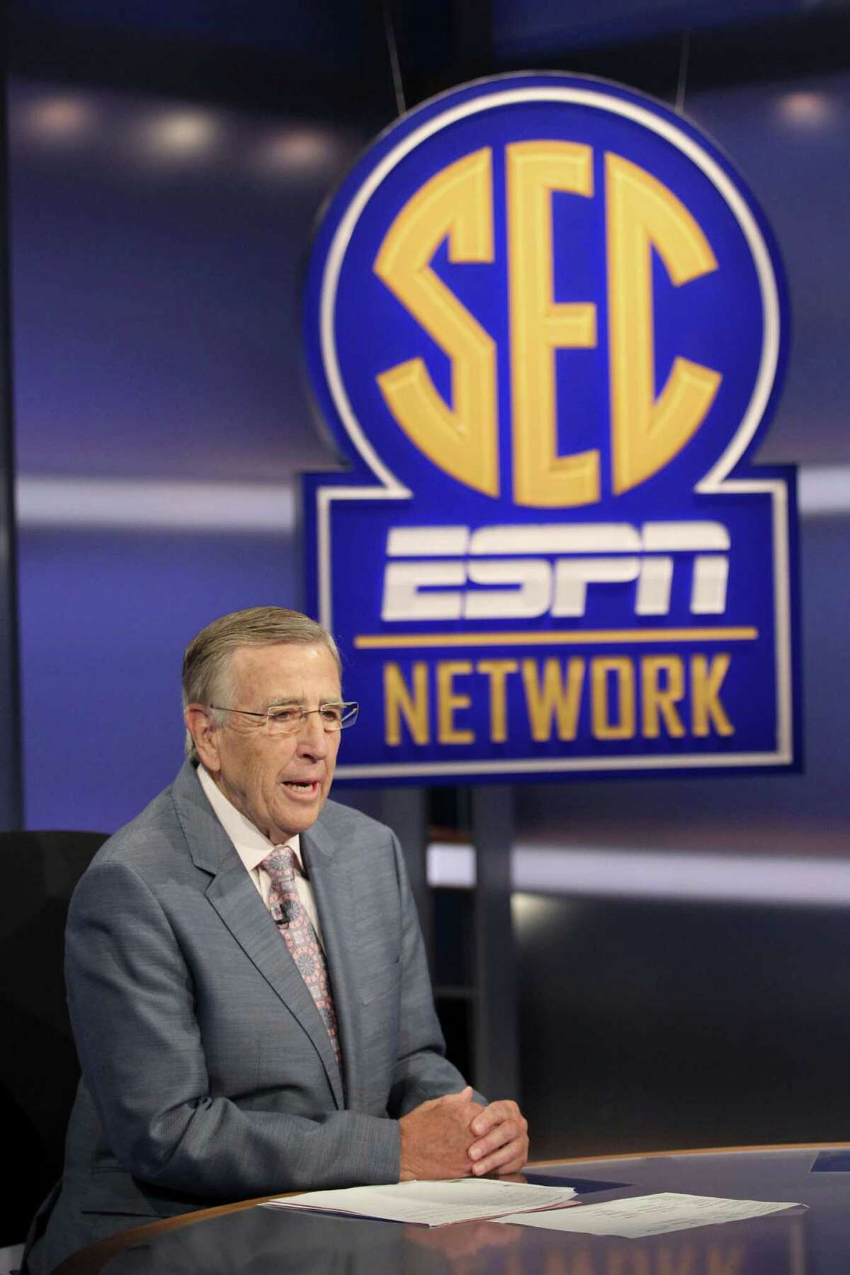 """In this Aug. 14, 2014, photo provided by ESPN, Brent Musburger is shown on the set of """"SEC Now"""" in Charlotte, N.C. Musburger is calling an end to his broadcast career. Millions of Americans experienced sporting events through his folksy narration, most often when he was the lead voice of CBS Sports during the 1980s. Musburger will call his last game for ESPN on Jan. 31, a college basketball contest pitting Kentucky against Georgia. (Travis Bell/ESPN Images via AP)"""