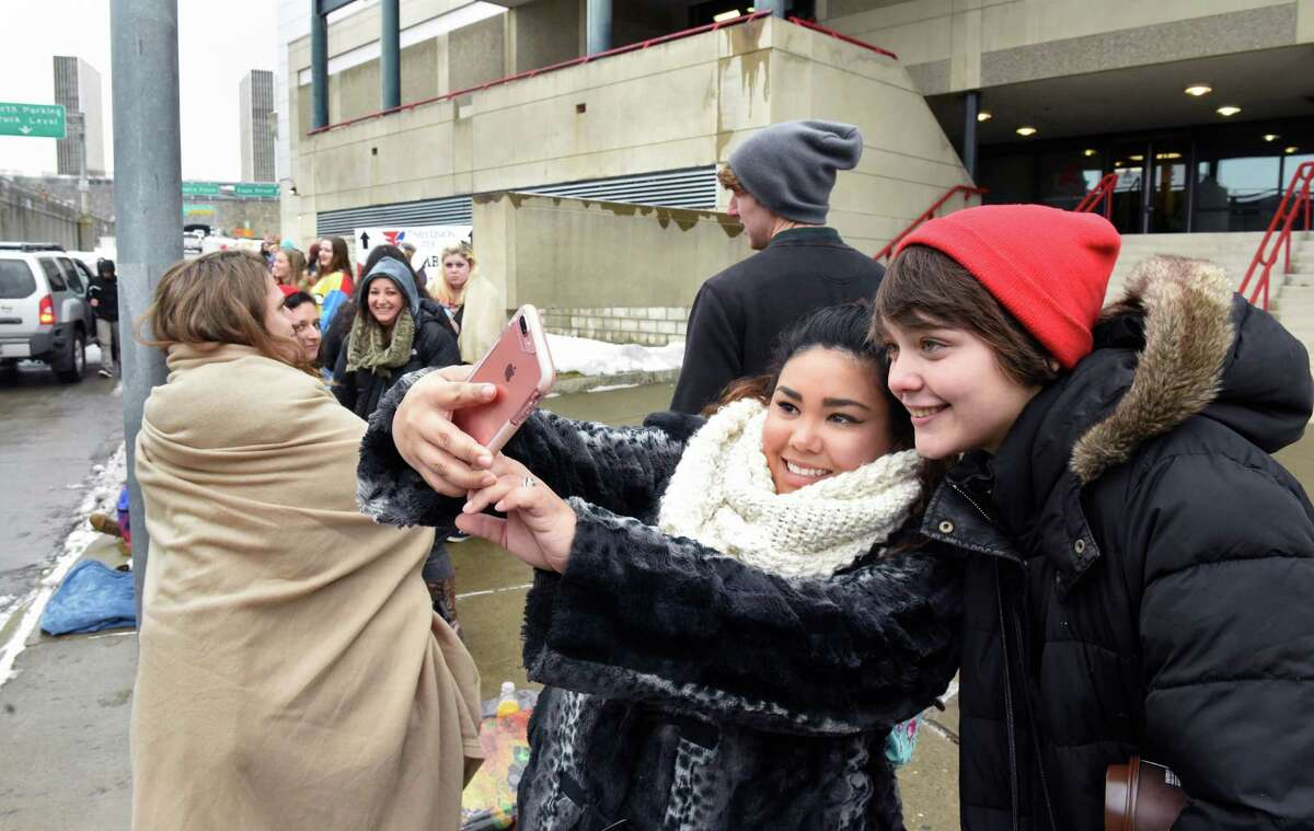 Ayla Forte of Utica and Shyla Deland, right, of Remsen take selfies as they wait in line for tonight's Twenty One Pilots concert at the Times Union Center Wednesday Jan. 25, 2017 in Albany, NY. (John Carl D'Annibale / Times Union)