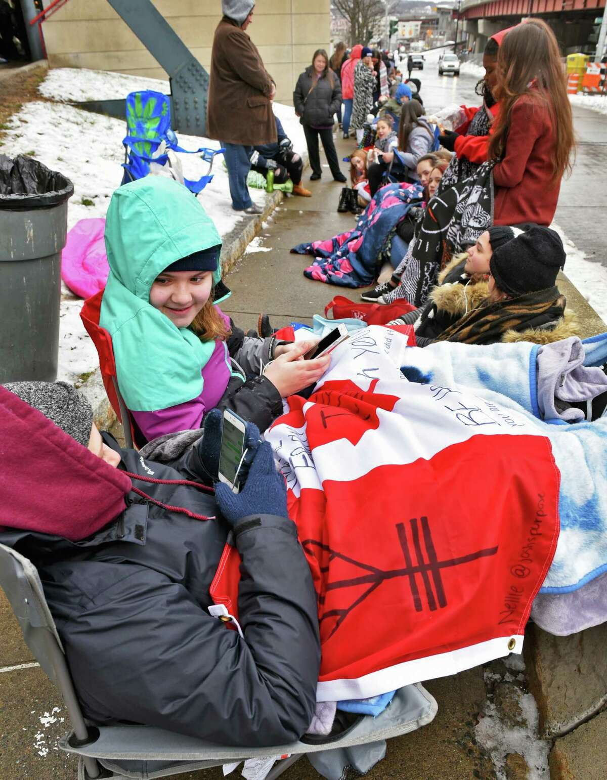 In line since 4AM, Stephanie Hamel, 17, left, and Nellie Mormul-Dubois, 16, of MontrŽal join fans queueing up for tonight's Twenty One Pilots concert at the Times Union Center Wednesday Jan. 25, 2017 in Albany, NY. (John Carl D'Annibale / Times Union)