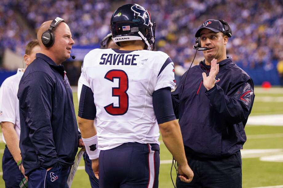 Houston Texans quarterbacks coach George Godsey, left, and head coach Bill O'Brien talk to quarterback Tom Savage during a time out in the fourth quarter of an NFL football game against the Indianapolis Colts at Lucas Oil Stadium on Sunday, Dec. 14, 2014, in Indianapolis. ( Brett Coomer / Houston Chronicle ) Photo: Brett Coomer, Staff / © 2014  Houston Chronicle