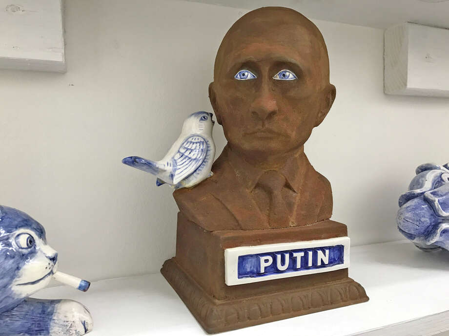 Charles Krafft's display of slip-cast porcelain objects featuring images of dictators is among works on view at Zoya Tommy Gallery. Photo: Molly Glentzer, Houston Chronicle