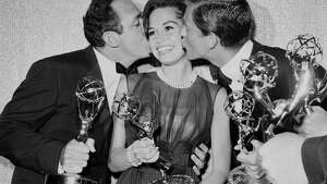 "Mary Tyler Moore is kissed by co-stars after receiving the Emmy Award for ""The Dick Van Dyke Show"" in Los Angeles, 1962."