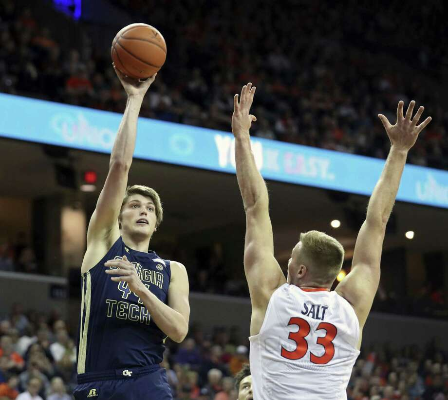 Georgia Tech center Ben Lammers (44) shoots over Virginia center Jack Salt (33) during the first half on Jan. 21, 2017, in Charlottesville, Va. Photo: Ryan M. Kelly /Associated Press / FR171063 AP