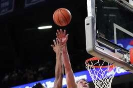 Clemson forward Jaron Blossomgame (5) shoots against Georgia Tech center Ben Lammers (44) in the second half on Jan. 12, 2017, in Atlanta. Tech won 75-63.