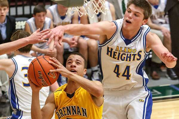Brennan's John Azzinaro (left) tries to get a shot past Alamo Heights' Ben Lammers during the first half of their boys basketball Region IV-4A final at Littleton Gym on March 2, 2013.
