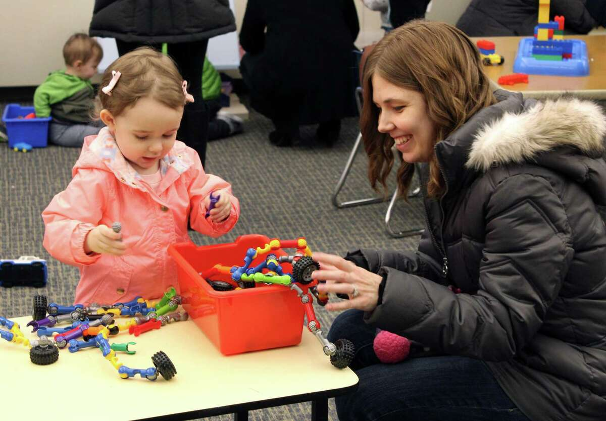 Audrey Sclafani and her daughter Sara playing with toys inside the new multipurpose room of Miller-Driscoll's pre-k wing.
