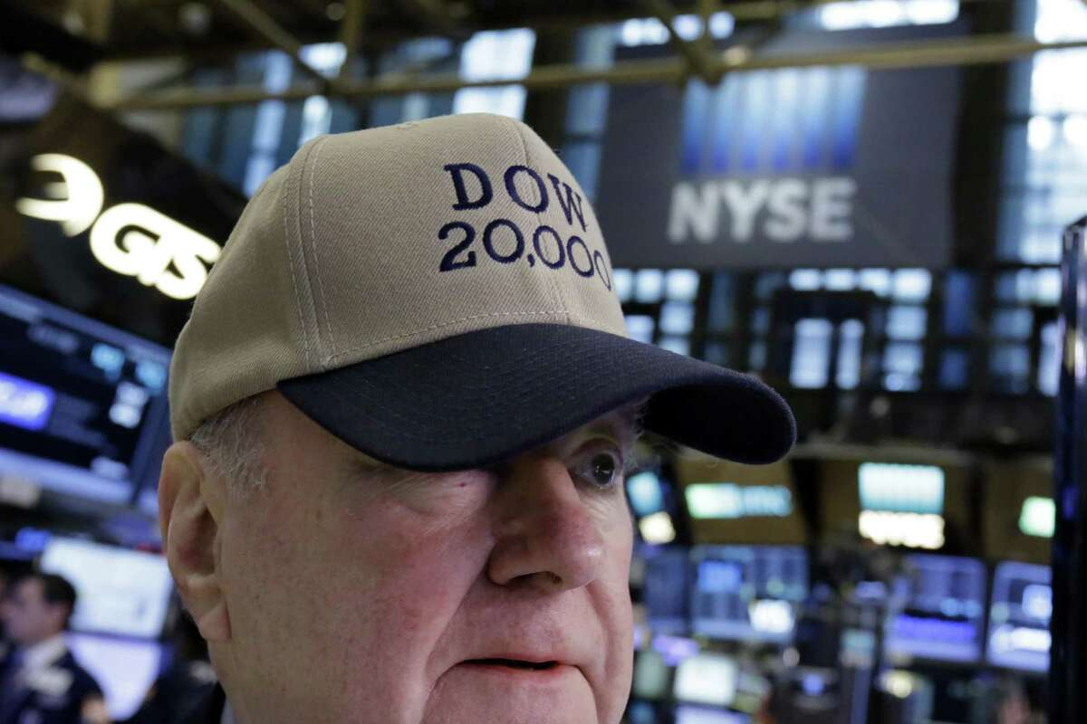 Arthur Cashin, director of floor operations for UBS Financial Services at the New York Stock Exchange, wears a Dow 20,000 hat, Wednesday, Jan. 25, 2017. The Dow Jones industrial average is trading over 20,000 points for the first time, the latest milestone in a record-setting drive for the stock market. The market has been marching steadily higher since bottoming out in March 2009 in the aftermath of the financial crisis. (AP Photo/Richard Drew)
