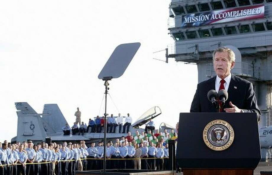 A May1, 2003 photo of George W. Bush addressing the nation aboard the nuclear aircraft carrier Abraham Lincoln as it sails for Naval Air Station North Island, San Diego, California. He declared that major combat in Iraq was finished. Photo: STEPHEN JAFFE, AFP/Getty Images