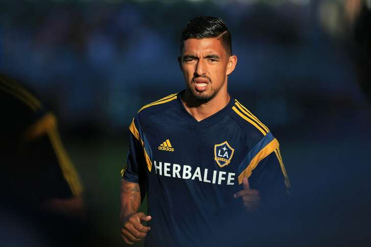 LOS ANGELES, CA - OCTOBER 19:  A.J. DeLaGarza #20 of Los Angeles Galaxy warms up prior to the MLS match against Seattle Sounders FC at StubHub Center on October 19, 2014 in Los Angeles, California. This is Donovan's last regular season MLS game before retiring at the end of the season. The Sounders and Galaxy played to a 2-2 draw.  (Photo by Victor Decolongon/Getty Images)