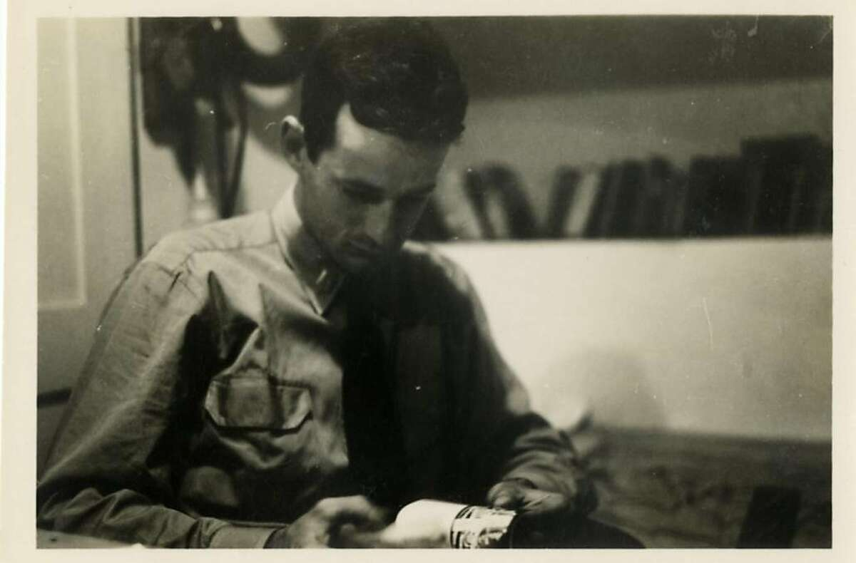 Lawrence Ferlinghetti reading in his subchaser during World War II.