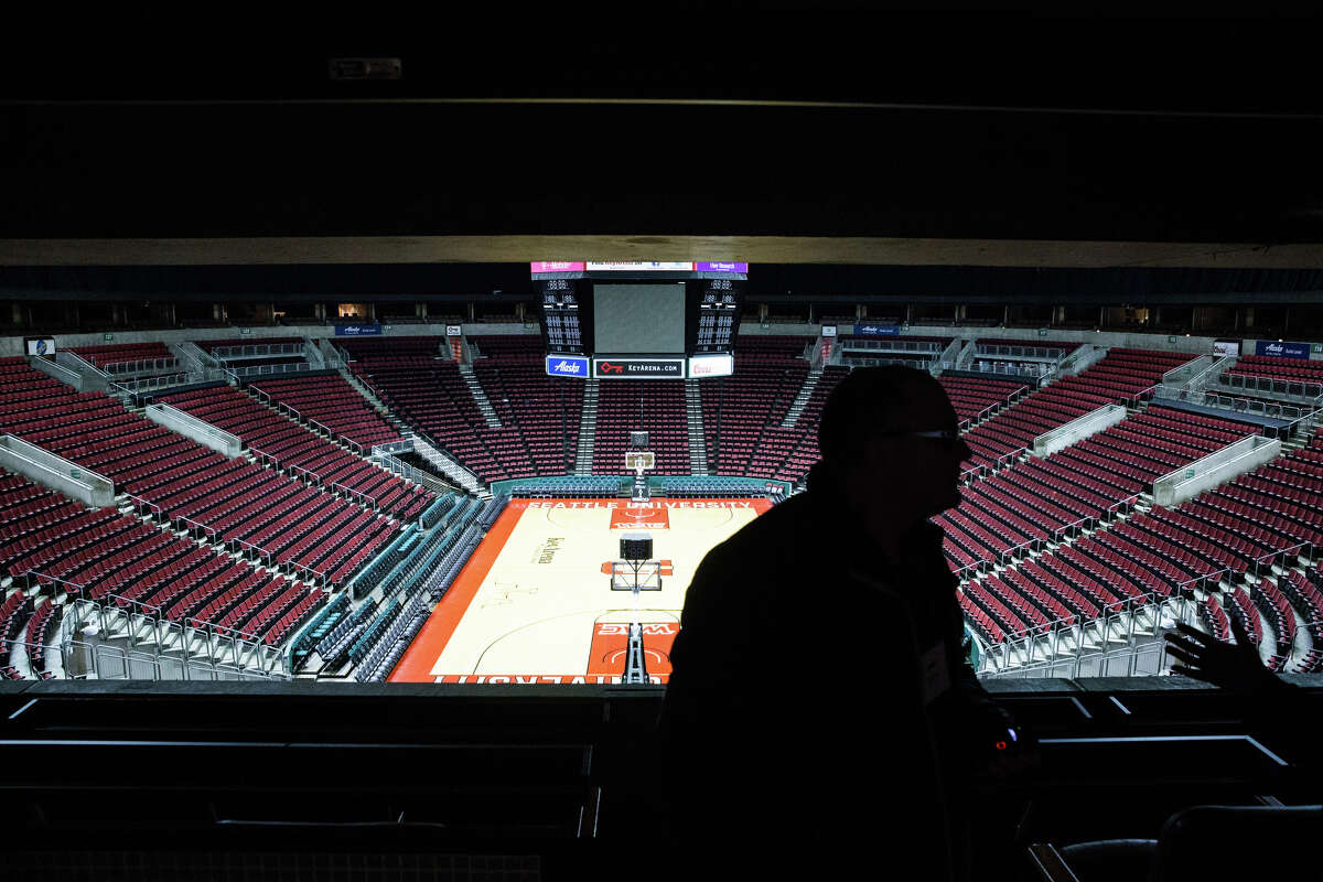 Potential developers and contractors tour KeyArena with city officials and local journalists on Wednesday, Jan. 25, 2017.