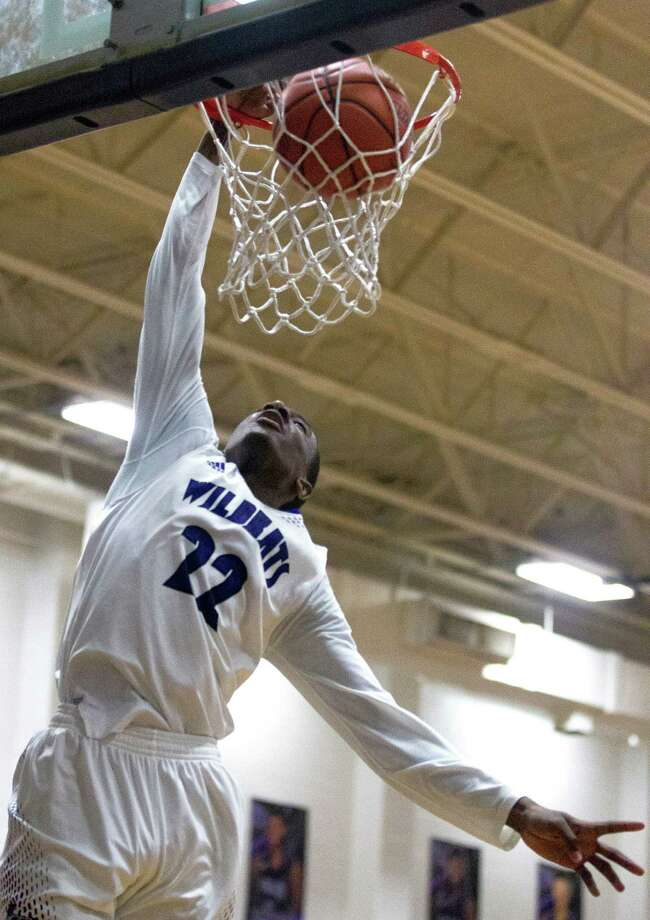 Willis' Darius Mickens (22) dunks the ball to pass the 1,000th career point mark during the second quarter of a District 20-5Ahigh school boys basketball game at Willis High School, Jan. 24, 2017, in Willis. Willis defeated Magnolia West 54-40. Photo: Jason Fochtman, Staff Photographer / Houston Chronicle