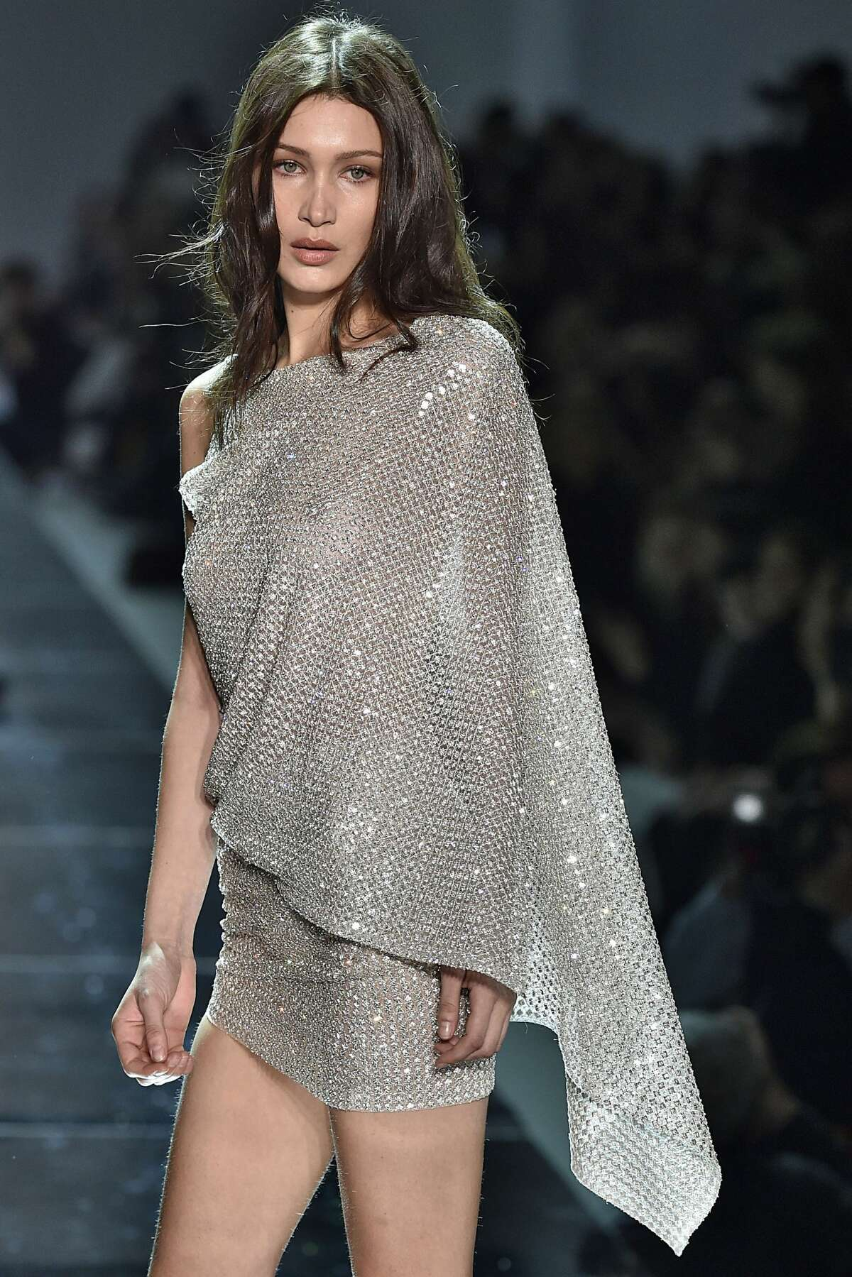 Bella Hadid walks the runway during the Alexandre Vauthier Spring Summer 2017 show in Swarovskicrystal dress. >>Keep clicking for more of Hadid's looks going down the Paris runways.