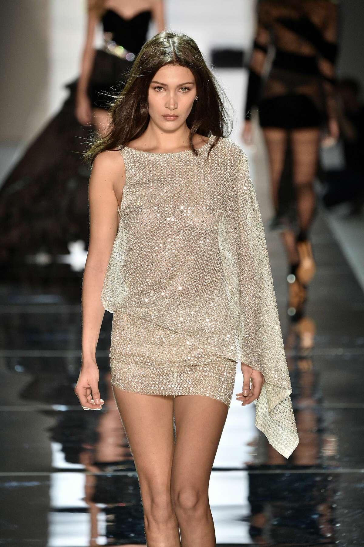 Bella Hadid walks the runway during the Alexandre Vauthier Spring Summer 2017 show in Swarovskicrystal dress.