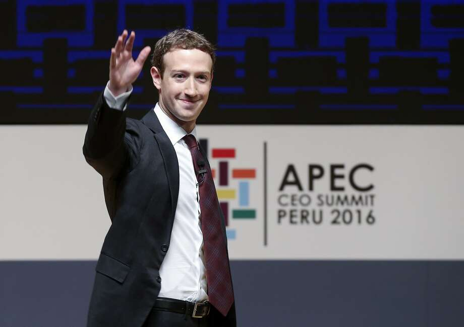 "The proposal, led by SumOfUs, claims that Facebook's future success requires ""a balance of power between the CEO and the board.,""Pictured - In this Saturday, Nov. 19, 2016 file photo, Mark Zuckerberg, chairman and CEO of Facebook, waves at the CEO summit during the annual Asia Pacific Economic Cooperation (APEC) forum in Lima, Peru. Photo: Esteban Felix, Associated Press"