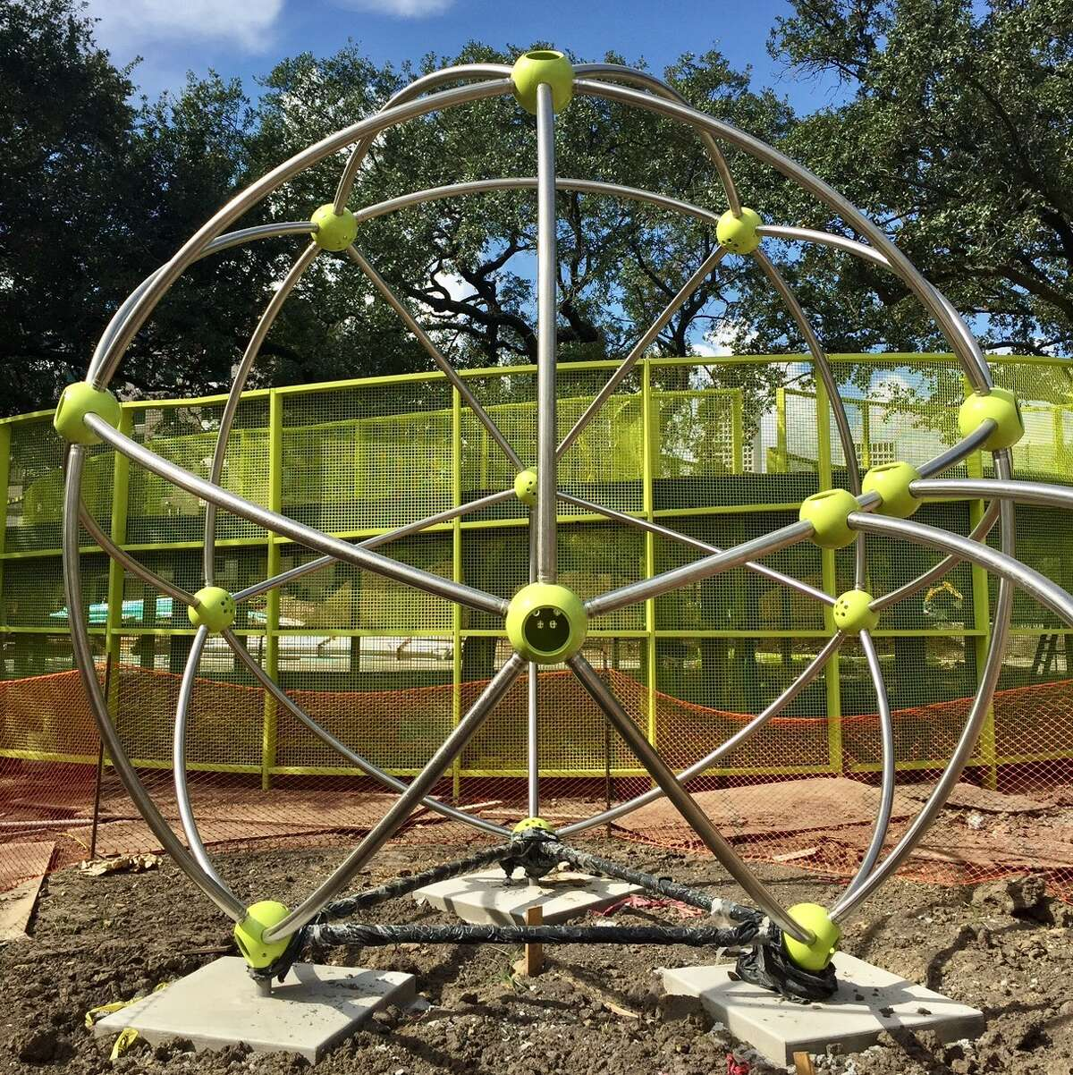 The Cosmo, a 14-foot climbing sphere, is part of the 24,000-square-foot area devoted to kids, families and play in Levy Park.