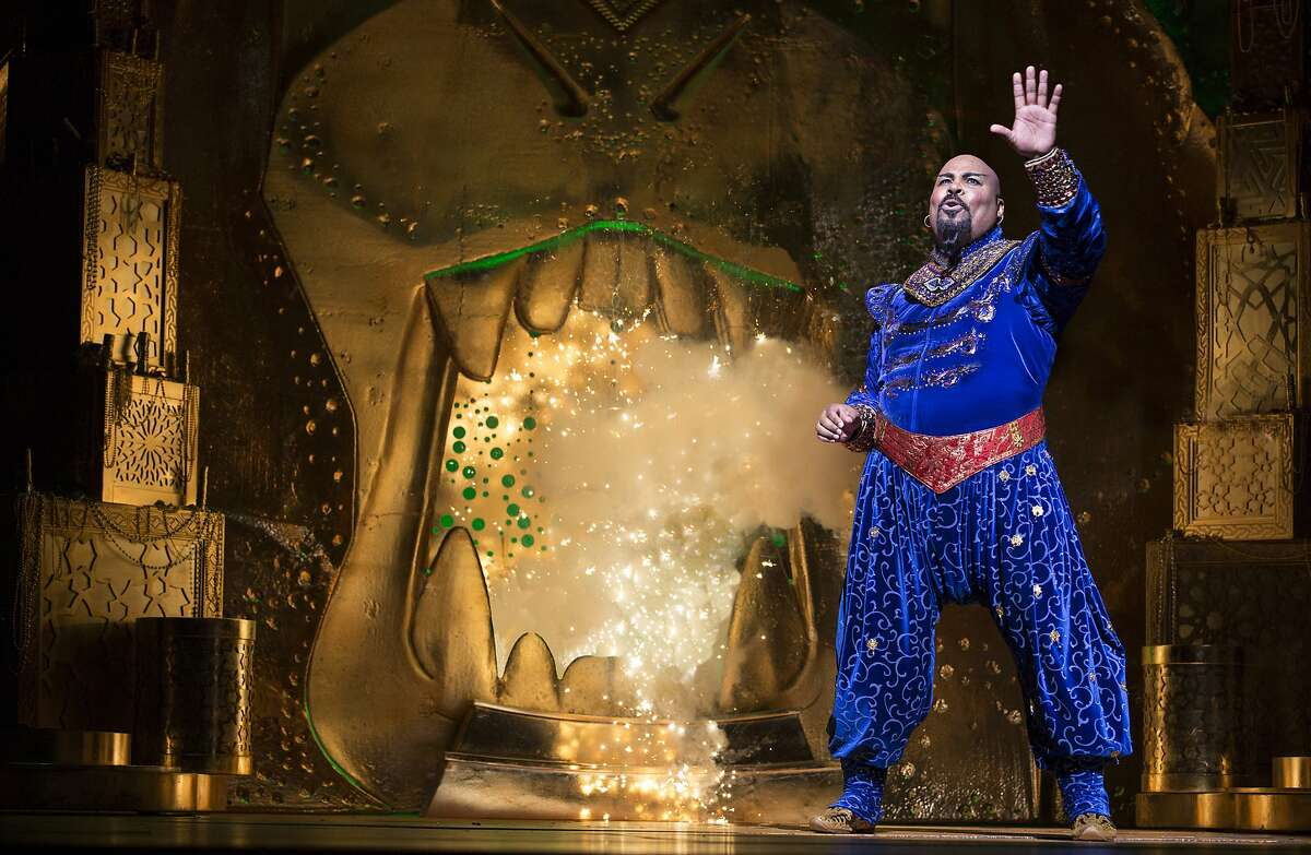 """FILE - This undated file image released by Disney Theatrical Productions shows James Monroe Iglehart as the Genie during a production of the musical """"Aladdin."""" The Broadway League released data Monday, Dec. 1, 2014, showing the 36 plays and musicals on the Great White Way earned more than $34 million over the week ending Sunday, with an average paid admission of $120. (AP Photo/Disney Theatrical Productions, Cylla von Tiedemann, File)"""