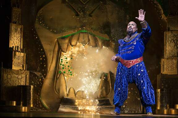 "FILE - This undated file image released by Disney Theatrical Productions shows James Monroe Iglehart as the Genie during a production of the musical ""Aladdin."" The Broadway League released data Monday, Dec. 1, 2014, showing the 36 plays and musicals on the Great White Way earned more than $34 million over the week ending Sunday, with an average paid admission of $120.  (AP Photo/Disney Theatrical Productions, Cylla von Tiedemann, File)"