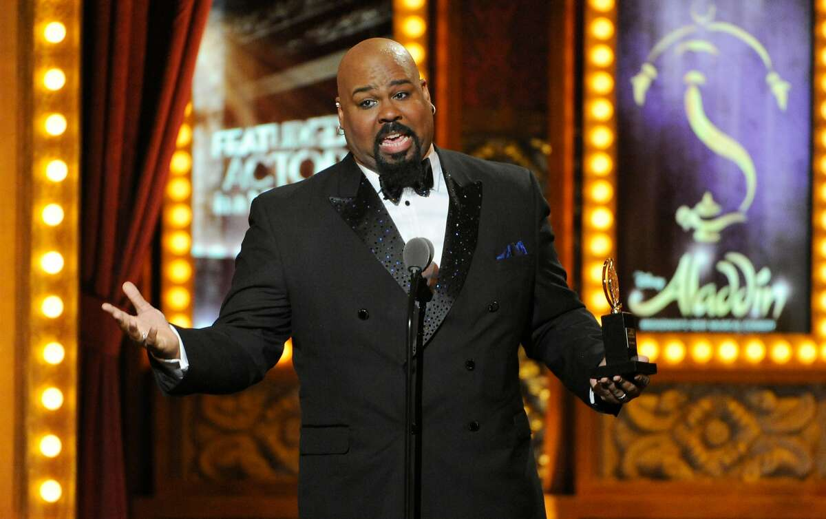 """James Monroe Iglehart accepts the award for best performance by an actor in a featured role in a musical for """"Aladdin"""" at the 68th annual Tony Awards at Radio City Music Hall on Sunday, June 8, 2014, in New York. (Photo by Evan Agostini/Invision/AP)"""