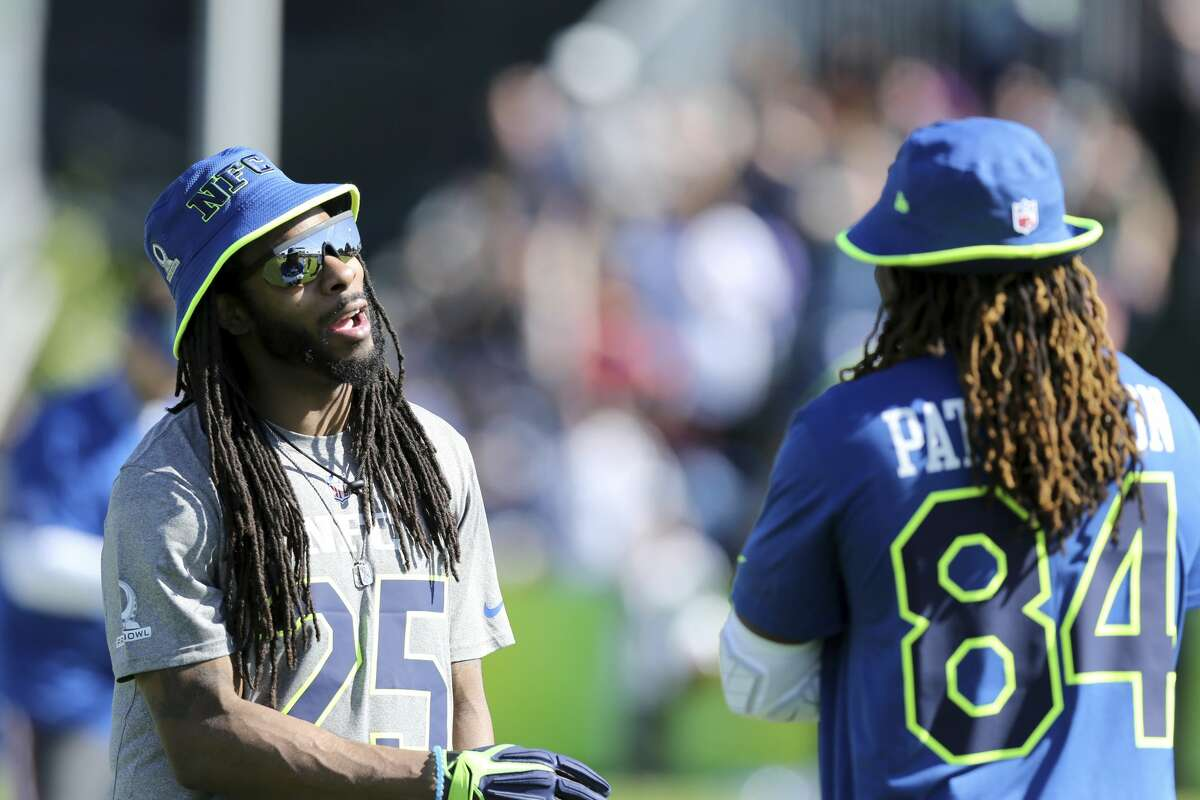 Minnesota Vikings Cordarrelle Patterson #84 interacts with Seattle Seahawks Richard Sherman #25 at the NFC Practice on Wednesday January 25, in Lake Buena Vista, FL. (AP Photo/Gregory Payan)