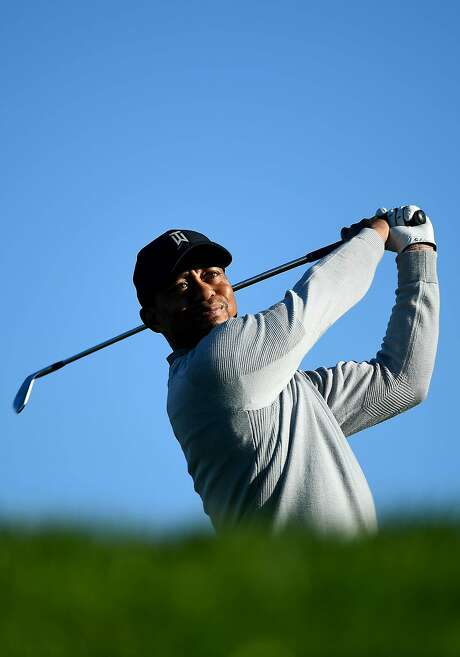 Tiger Woods gets in a practice round at Torrey Pines ahead of his first official PGA Tour start in 17 months. Photo: Donald Miralle, Getty Images