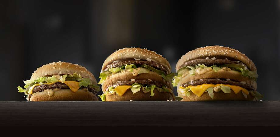 This photo provided by McDonald's shows, from left to right: McDonald's Mac Jr., Big Mac and Grand Mac. McDonald's is testing bigger and smaller versions of its Big Mac as the world's biggest hamburger chain pushes to revive its business. The company says it's testing the Grand Mac and Mac Jr. in the Central Ohio and the Dallas areas, and will see how they do before deciding on a national rollout. (McDonald's via AP) MANDATORY CREDIT Photo: Associated Press