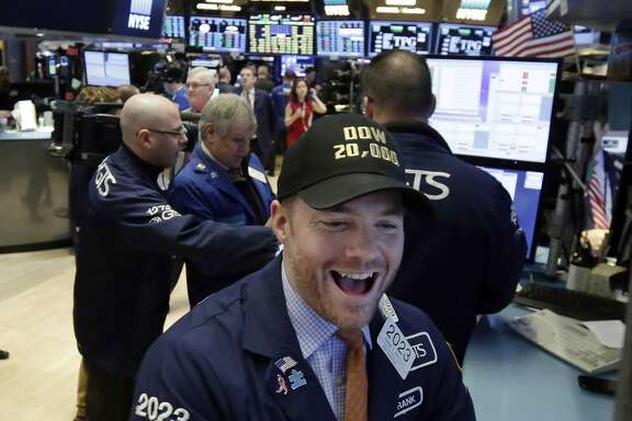 Specialist Frank Masiello wears a Dow 20,000 cap as he works on the floor of the New York Stock Exchange, Wednesday, Jan. 25, 2017. The Dow Jones industrial average is trading over 20,000 points for the first time, the latest milestone in a record-setting drive for the stock market. The market has been marching steadily higher since bottoming out in March 2009 in the aftermath of the financial crisis. (AP Photo/Richard Drew)