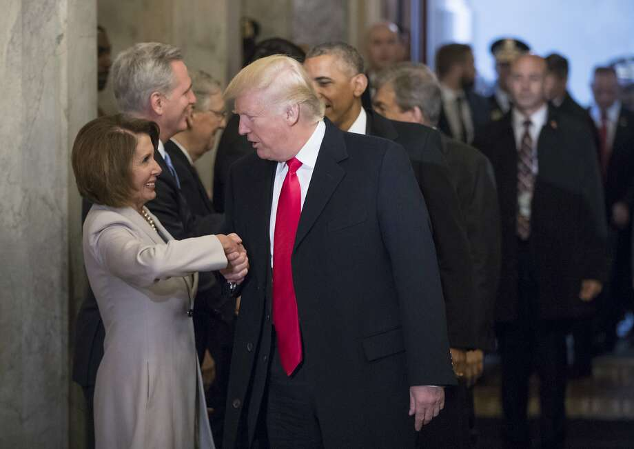 Donald Trump greets House Minority Leader Nancy Pelosi before his inauguration ceremony in January. After Trump's comments on Confederate statues, Pelosi has called for their removal from Capitol Hill. Photo: J. Scott Applewhite, Associated Press