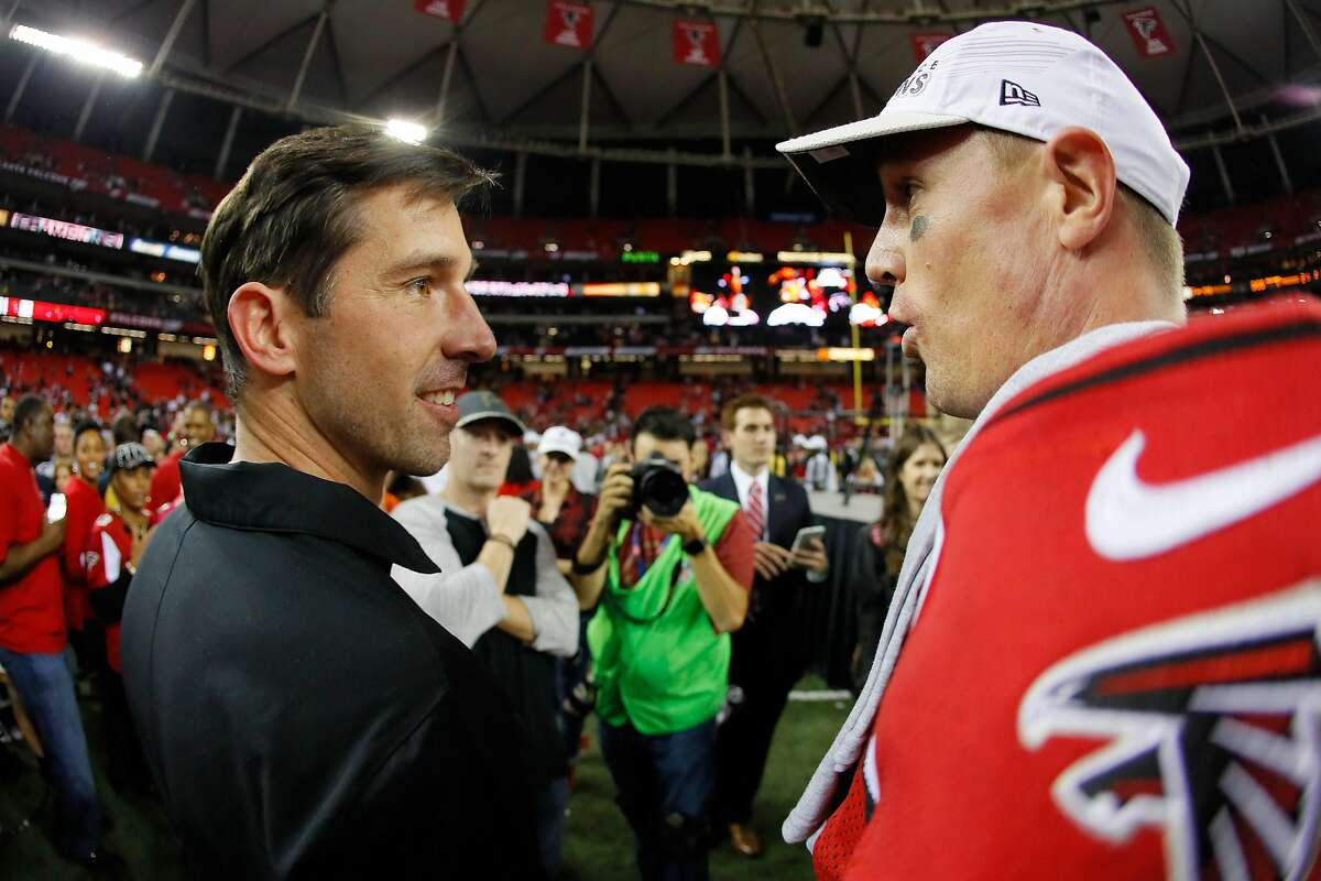 ATLANTA, GA - JANUARY 22: Atlanta Falcons offensive coordinator Kyle Shanahan celebrates with Matt Ryan #2 after defeating the Green Bay Packers in the NFC Championship Game at the Georgia Dome on January 22, 2017 in Atlanta, Georgia. The Falcons defeated the Packers 44-21. (Photo by Kevin C. Cox/Getty Images)