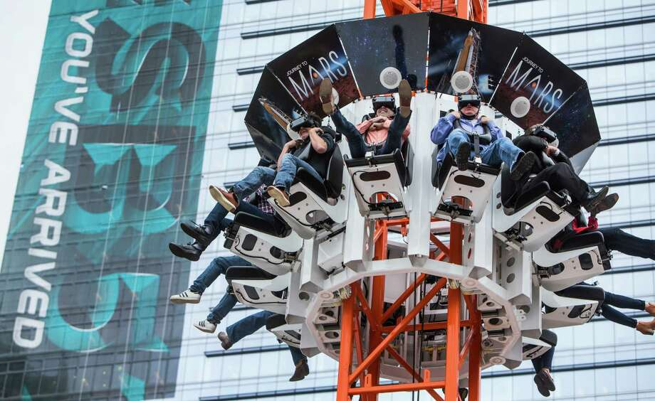 "People free fall as they ride the Future Flight, virtual reality ride at Discovery Green on Wednesday, Jan. 25, 2017, in Houston.  The so-called Super Bowl Live ""Wow Factor"" is a free drop-tower, that has people wear virtual reality goggles, ride to the top and free fall, getting the a virtual sensation of a journey to Mars and back. ( Brett Coomer / Houston Chronicle ) Photo: Brett Coomer, Staff / © 2017 Houston Chronicle"