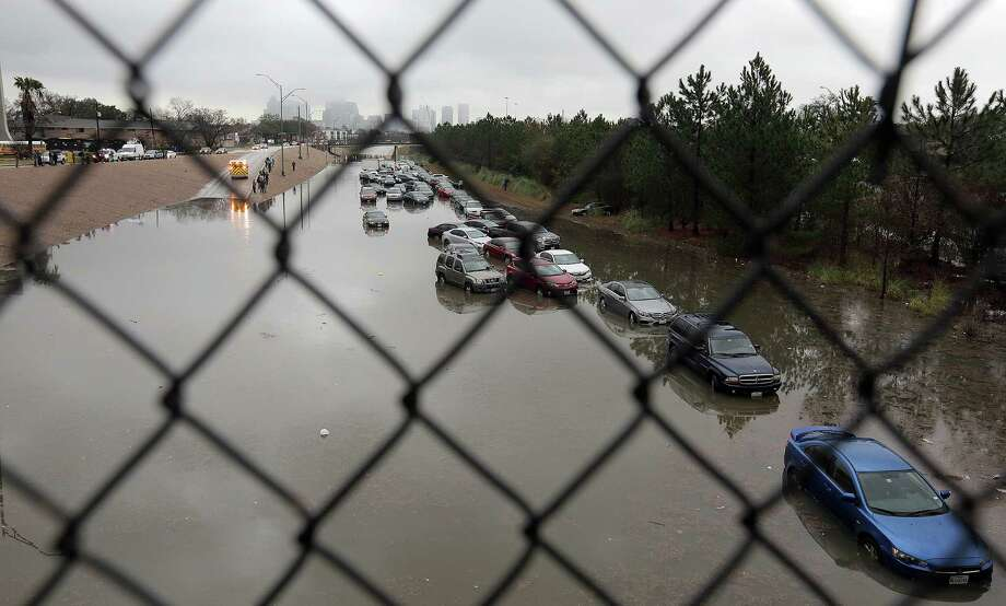 Cars stand abandoned on Texas 288 near Calumet after heavy rains last week caused flooding. Photo: Elizabeth Conley, Staff / © 2017 Houston Chronicle
