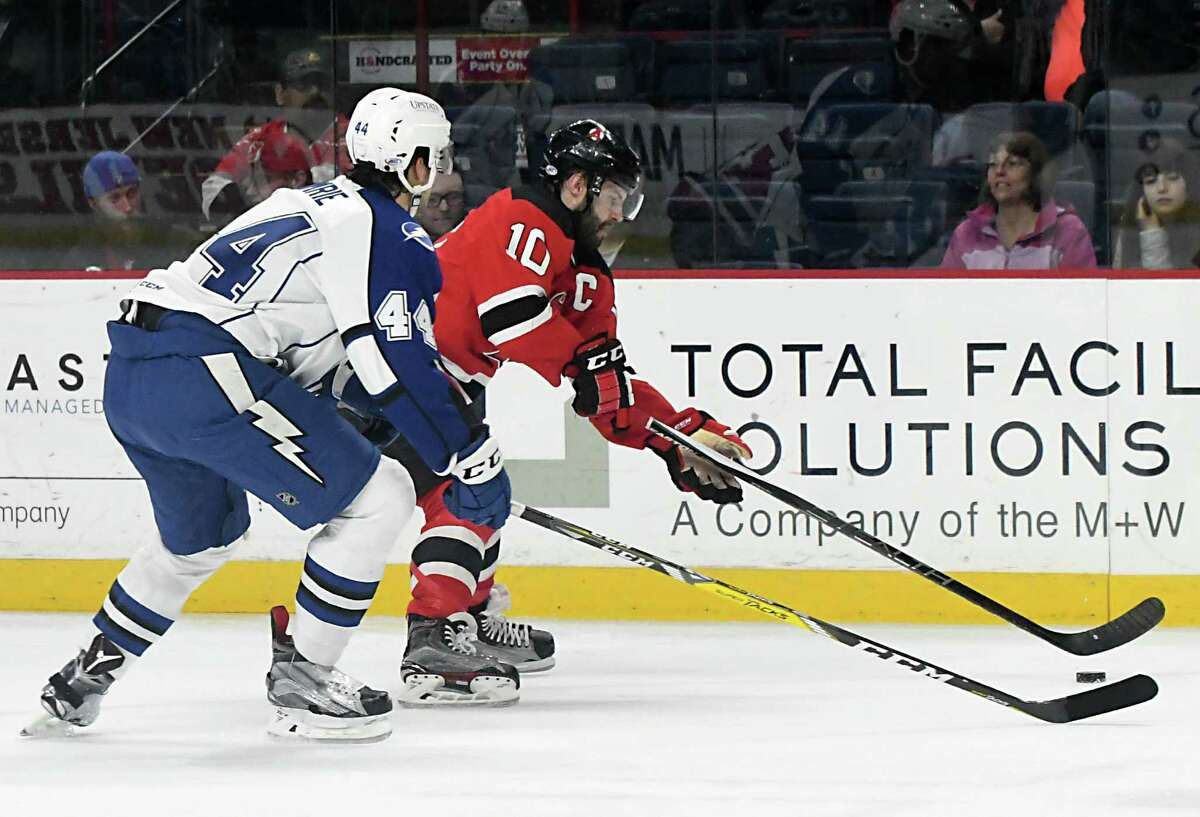 Albany Devils' Rod Pelley, #10, and Syracuse Crunch's Adam Comrie battle for the puck during a hockey game at the Times Union Center on Wednesday, Jan. 18, 2017 in Albany, N.Y. (Lori Van Buren / Times Union)