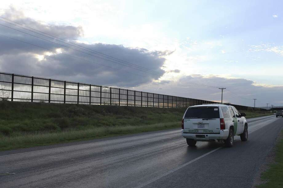 A U.S. Border Patrol unit makes its way along U.S. 281 by the U.S.-Mexico border wall near San Benito, Texas, Sunday, Oct. 2, 2016. The wall stretches in a series of broken links from Brownsville to Hidalgo County. Interest in continuing the construction of the wall was sparked by Republican presidential nominee Donald Trump. Photo: JERRY LARA, Staff / San Antonio Express-News / © 2016 San Antonio Express-News