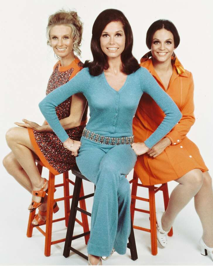 "Left to right are Cloris Leachman, Mary Tyler Moore and Valerie Harper in a publicity portrait for ""The Mary Tyler Moore Show,"" circa 1974. The show was considered part of a golden age in television for that period. It starred Leachman as Phyllis Lindstrom, Tyler Moore as Mary Richards, and Harper as Rhoda Morgenstern. (Photo by Silver Screen Collection/Getty Images)"