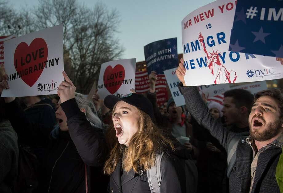 People hold signs and chant as the Council on American Islamic Relations holds a protest against President Donald Trump's planned ban on Muslim travel in Washington Square Park in New York on January, 25, 2017.  / AFP PHOTO / Bryan R. SmithBRYAN R. SMITH/AFP/Getty Images Photo: BRYAN R. SMITH, AFP/Getty Images
