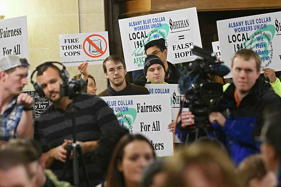 Protesters chant loudly as Mayor Kathy Sheehan tries to offer her vision for the future of the city during her state of the city address at Albany City Hall on Wednesday, Jan. 25, 2017 in Albany, N.Y. The protesters were marching for Donald ODontayO Ivy and because the Albany local blue collar workers Local 1961 haven't received a raise in four years. (Lori Van Buren / Times Union) Photo: Lori Van Buren / 20039537A