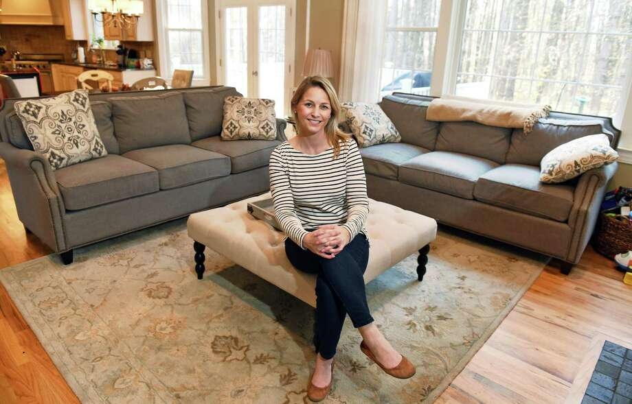 Jodi Emmons and her three-seat transitional couches, she loved them so much that she bought two, in her home Friday Nov. 18, 2016 in Wilton, NY.  (John Carl D'Annibale / Times Union) Photo: John Carl D'Annibale / 20038806A