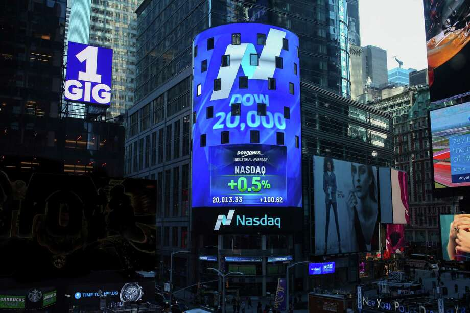 The Nasdaq Tower in New York's Times Square shows the Dow Jones industrial average crossing the 20,000 mark on Wednesday. Photo: Rohini Shahriar, HONS / Copyright Nasdaq 2017