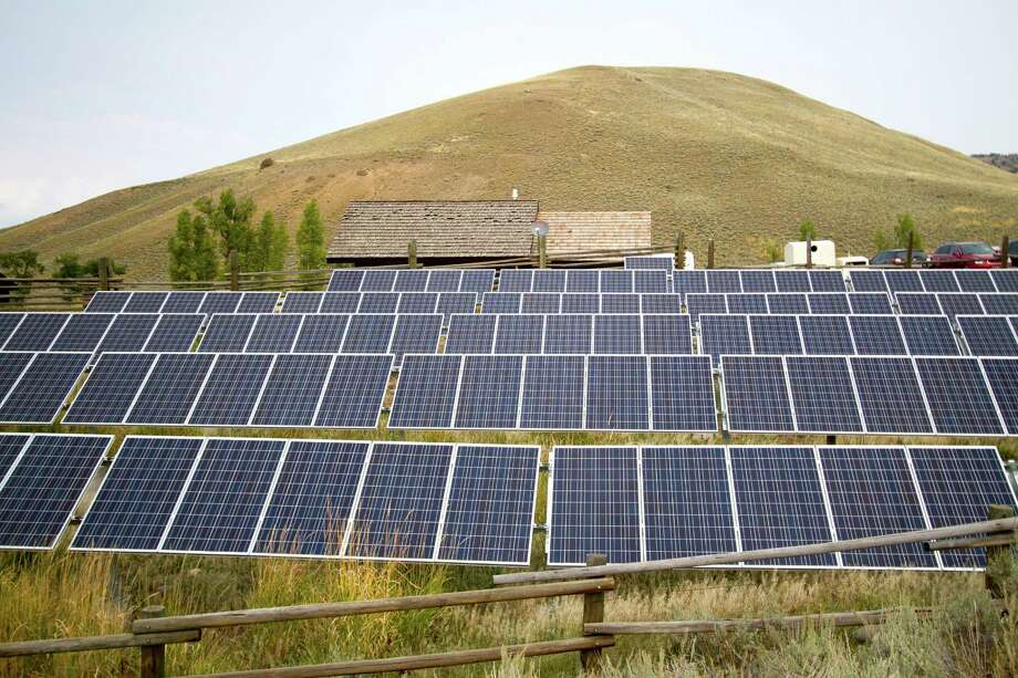 FILE - This Aug. 27, 2015, file photo shows a solar power array that is part of sustainability improvements at the Lamar Buffalo Ranch in Yellowstone National Park, Wyo. In recent years, huge solar and wind farms have sprouted up on public desert land in the Western United States buoyed by generous federal tax credits. A group of lawmakers in the most Republican statehouse in the country is bucking the nationwide trend toward stricter renewable energy requirements with a plan to do the opposite: Require utilities to get their electricity from fossil fuels or face fines. (Ryan Jones/Jackson Hole News & Guide via AP, File) Photo: Ryan Jones, MBR / Jackson Hole News & Guide