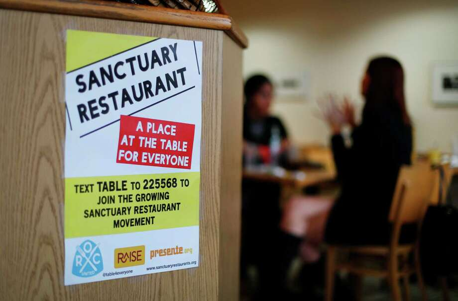 Restaurants taking part in the sanctuary program, such as the Russell Street Deli in Detroit, receive training on civil rights. Photo: Paul Sancya, STF / Copyright 2017 The Associated Press. All rights reserved.